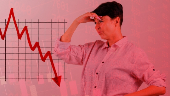 a woman looks stressed as her stock portfolio crashses